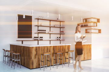 Blonde woman in wooden bar interior