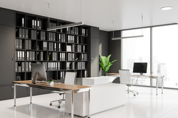 Panoramic manager office corner with bookcase