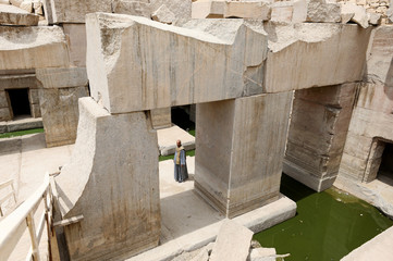 A worker stands beside the pond at new groundwater lowering project, behind Temple of Seti I, Abydos archeological site