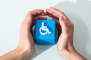 Human Protecting Cubic Block With Disabled Handicap Icon