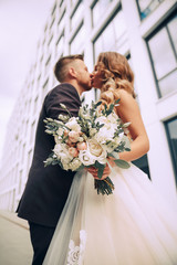 Couple in love on a walk in the city.The couple on the background of a modern building.Wedding photo