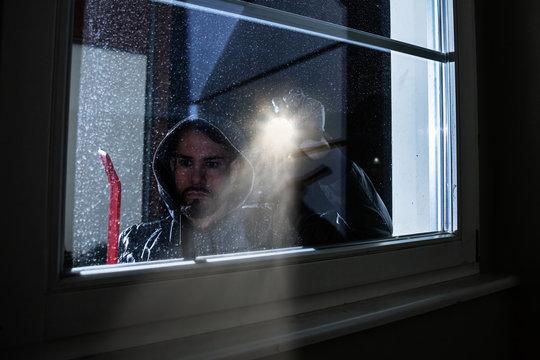 Burglar Looking Into A House Window