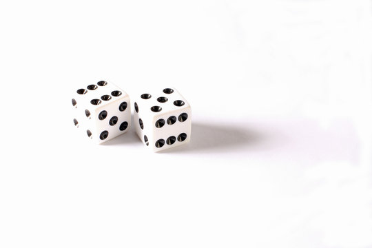Seven and Eleven displayed on set of white dice against white BG