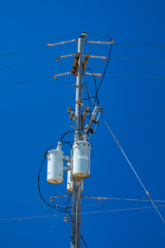 Electric pole with a transformer and wires