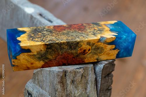 Casting epoxy resin Stabilizing Afzelia burl exotic wood, close up