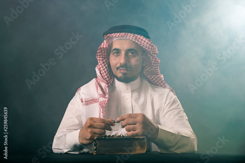 Oriental man in a white, traditional, national, Arabic dress