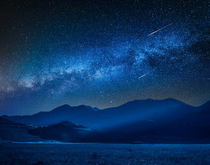 Fotobehang Nachtblauw Milky way over Castelluccio at night, Umbria, Italy