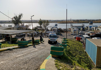 General view of the scene where an overloaded ferry sank in the Tigris river near Mosul in Iraq