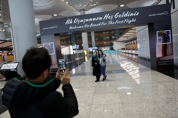 Airport workers pose for a picture at the city's new Istanbul Airport in Istanbul