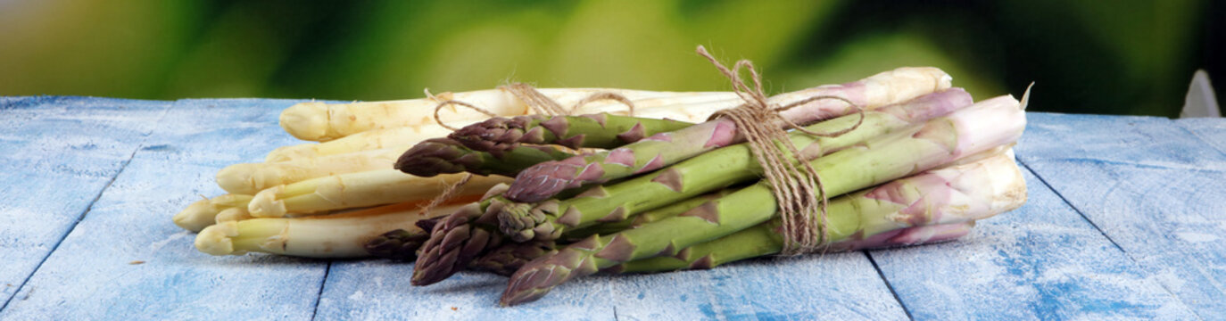 White and green asparagus on vintage old background.