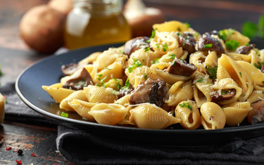 Carbonara mushrooms pasta Conchiglie with creamy sauce, parmesan cheese and herbs