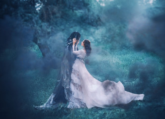 brunette girl ghost and spirit of nightly mysterious cold blue forest, lady in white vintage lace dress with long flying train hugs dark terrible death god, lost sinful soul in thick fog, black smoke Wall mural
