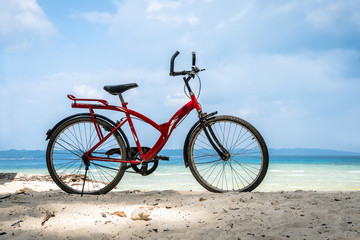 Bicycle parked by the sea
