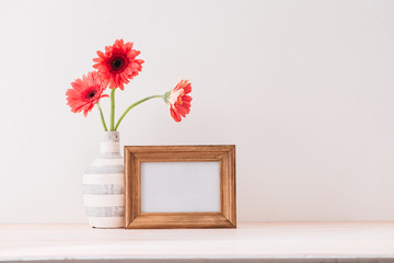 White landscape frame mock up with a vase of gerbera beside the frame, overlay your quote, promotion, headline, or design, great for small businesses, lifestyle bloggers and social media campaigns