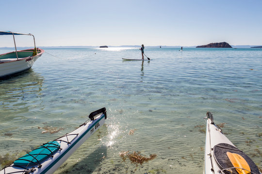 children on stand up paddle boards and in kayaks, Isla Espiritu, Sea of Cortez