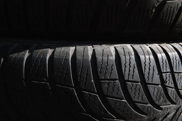 Black tyres background picture. Black texture, backdrop