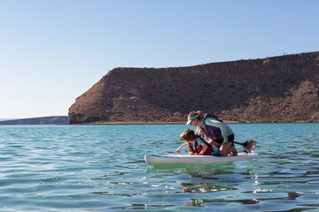 children kayaking and stand up paddle boarding, Isla Espiritu