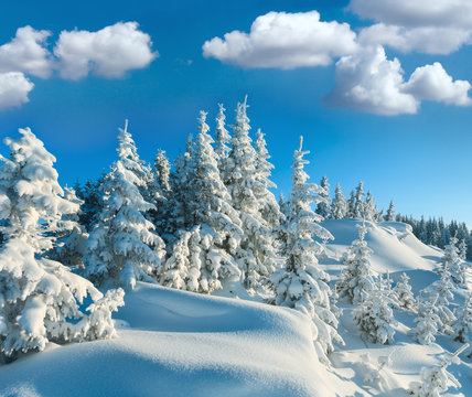 Snowdrifts on winter snow covered mountainside