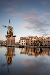 Windmill and traditional houses, Haarlem, Holland