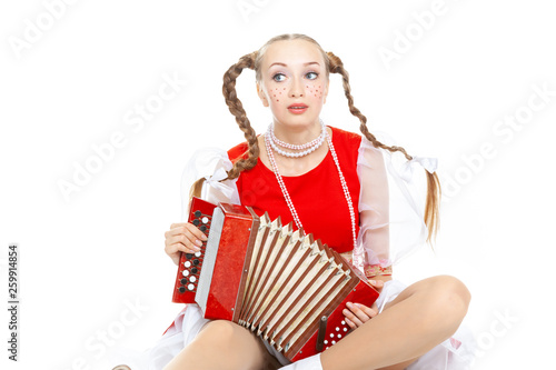Pretty young sad woman with ridiculous plaits in russian