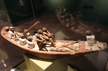 Small statues inside a boat on display at the Sohag National Museum, Sohag