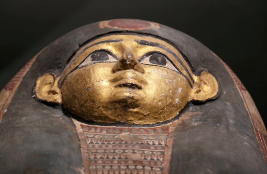 The face of a Pharaonic sarcophagus painted in gold on display at the Sohag National Museum, Sohag