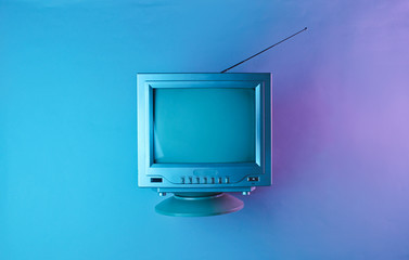 Retro wave, 80s. Old tv with antenna in holographic light. Top view, minimalism