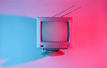 Retro wave, 80s. Old tv with antenna with neon light. Top view, minimalism