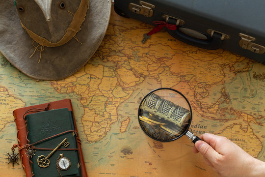 Treasure hunt, old map with treasure chest and expedition equipment in vinatge style