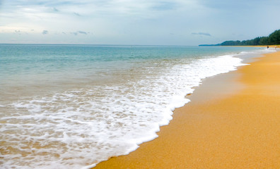 beach with beautiful sand and blue water