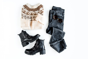 Wall Mural - Women fashion clothes and accessories. Feminine youth collage on white background top view. Flat lay female style look with warm sweater, jeans, boot, sunglasses. Top view.