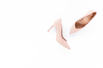 Wall Mural - Pastel pink women high heel shoes on pink background. Flat lay, top view trendy fashion feminine background. Beauty blog concept. Fashion blog look.