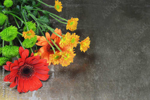 Mothers Day flowers on rusty background with copy space