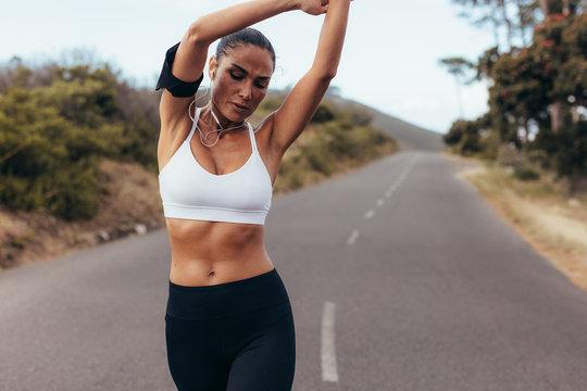 Female runner relaxing her muscles