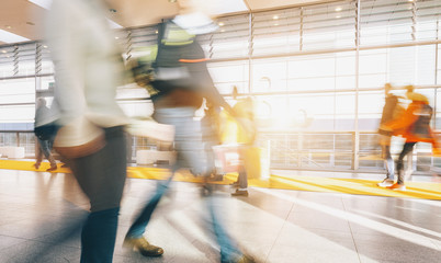Fototapete - blurred commuters at a trade fair