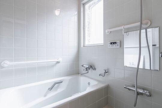 Large white bathtub in new modern bathroom