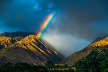 Bright rainbow over the mountains. Maui, Hawaii