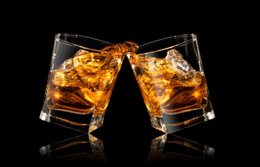 glasses of whiskey making toast