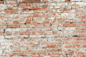 Old painted red brick wall background and texture
