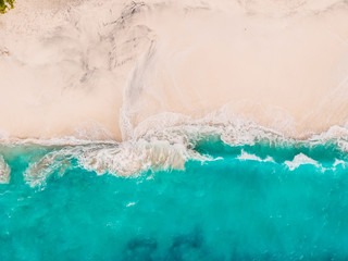 Tropical sandy beach with turquoise ocean and waves. Aerial view