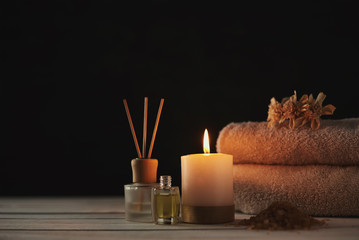 Towels, candle and massage oil on white table Fototapete