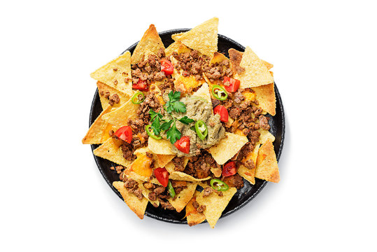 Corn chips nachos with fried minced meat and guacamole isolated on white background.