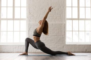 Sporty woman practicing yoga, standing in anjaneyasana pose, Horse rider Fototapete