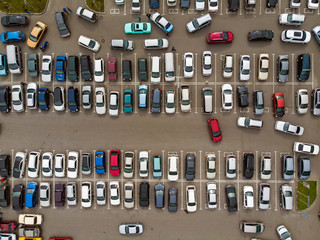 A view from above to the lines of parked cars. Heavy traffic in the parking lot. Searching for spaces in the busy car park. Cruising for parking in dormitory area. Difficulties of parking in the city Fototapete