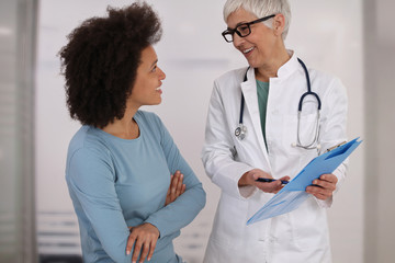 Woman Doctor and patient talking about medical report Good new concept. Professional medical help,support, advice Female health , gynecology concept