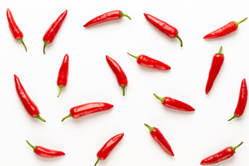 Wall Murals Hot chili peppers Chili or chilli cayenne pepper isolated on white background cutout.