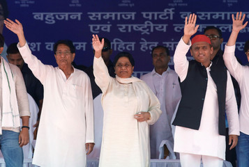 Bahujan Samaj Party (BSP) Chief Mayawati, Chief of Samajwadi Party (SP) Akhilesh Yadav and Chief of Rashtriya Lok Dal Ajit Singh wave towards the crowd during their joint election campaign rally in Deoband, in the northern Indian state of Uttar Pradesh