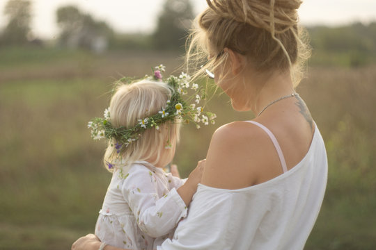 child with mother in the meadow