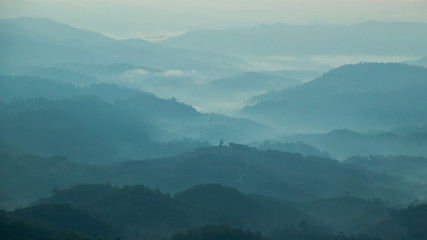 mountains valley with the sea of fog and clouds.Layers of mountains in morning sunrise. Wall mural
