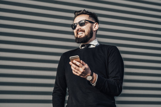 fashion beard man portrait, Handsome man beard using smartphone in hand, happy face, street photo, hipster style portrait, isolated, make video, instagram. facebook